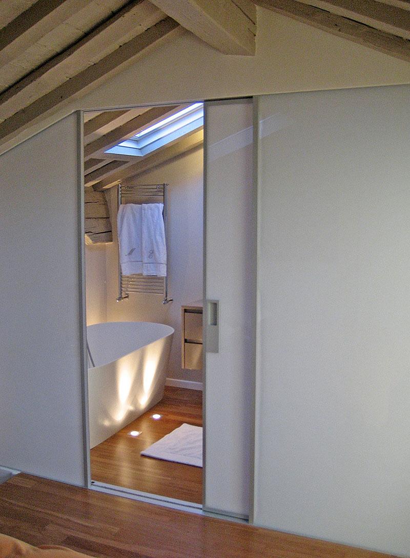 Interior design, progettazione outdoor e disegno arredi in un atttico